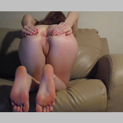 Amateur-Redhead-Teen-Laura-Cross-on-Beige-Couch