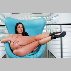 Angela-White-Big-Natural-Tits-Heels-Collar-on-Blue-Armchair-from-NaughtyAmerica