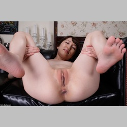 Asian-Japanese-Small-Tits-Black-Couch-from-GirlsDelta