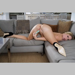 Blonde-Bailey-Brooke-Black-Heels-Vibrator-on-Grey-Couch-from-InTheCrack
