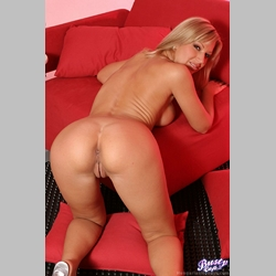 Blonde-MILF-Carol-Goldnerova-on-Red-Armchair-from-BustyCafe
