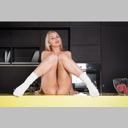 Blonde-Darina-Nikitina-Sock-on-Table-in-Kitchen-from-SexArt-30.jpg