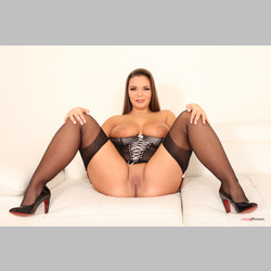 Brunette-Sofia-Lee-Big-Natural-Tits-Black-Lingerie-on-White-Couch-from-LegalPorno