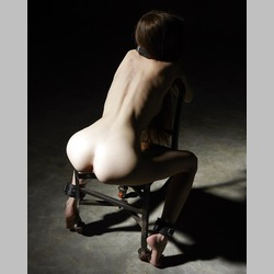 Skinny-Brunette-Emily-Bloom-Attached-on-Chair-Bondage-Black-Background