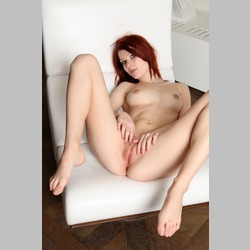 Redhead-Mia-Sollis-on-White-Couch-2.jpg