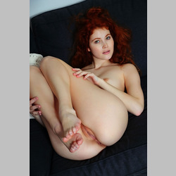 Skinny-Redhead-Heidi-Romanova-on-Blue-Couch-from-MetArt