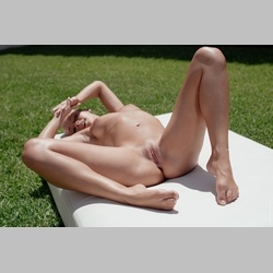 Blonde-Naomi-Nevena-on-Mattress-in-Garden-from-WowGirls